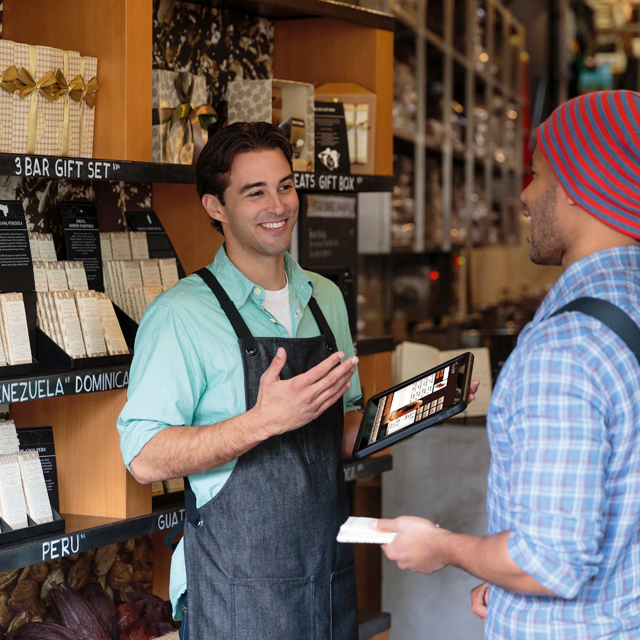 Sales associate using mobile POS to engage with customer