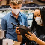 couple wearing face masks pan shopping