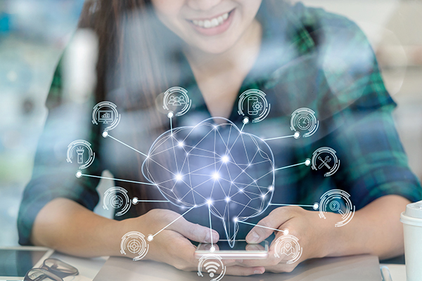 woman smiling down at her phone, illustration of brain with points connected to different technological, artificial intelligence symbols in circles around it