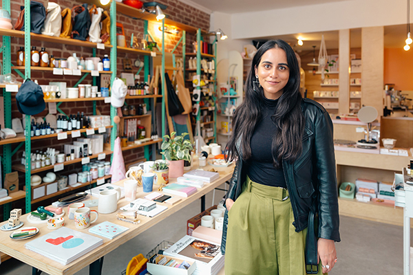 shopkeeper lady in a store with various types of products omnichannel strategies