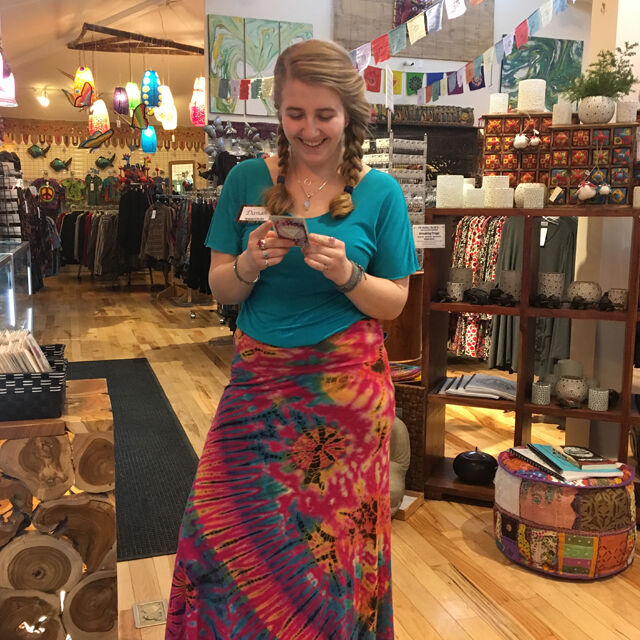 Woman in dress inside boho store