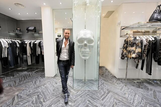 Man welcoming you to the entrance of a high-end retail store
