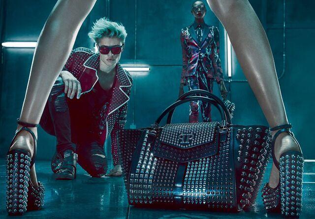 Male model in futuristic leather and sunglasses