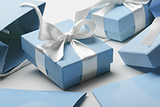 giftboxes wrapped elegantly with a bow